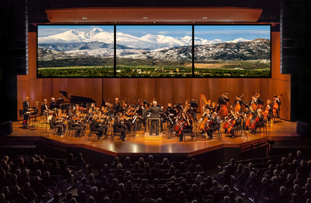 Fort Collins Symphony Orchestra with Rocky Mountains in background by Westwater Arts